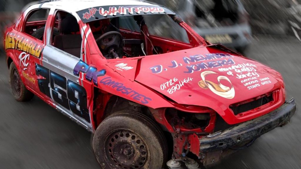 Photo of stock car with DJ Newman advert on bonnet